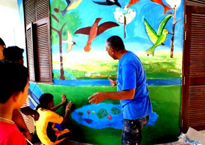 Children working with mural artist